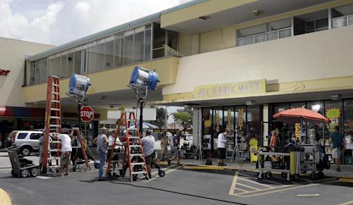 "In this July 24, 2013, photo, crews prepare the set for rehearsal and taping of an episode of ""Burn Notice"" in Miami. The cable spy drama is coming to an end after seven seasons with a big finale Thursday, Sept. 12, 2013. (AP Photo/Alan Diaz)"