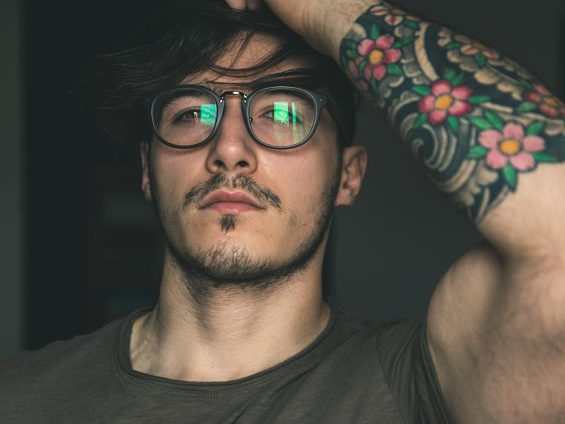 Pictured: Young man with tattoo. Image: Getty