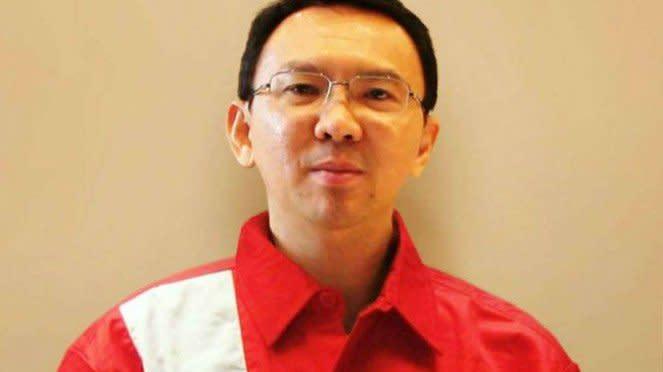 Basuki Tjahaja Purnama alias Ahok berseragam Pertamina.