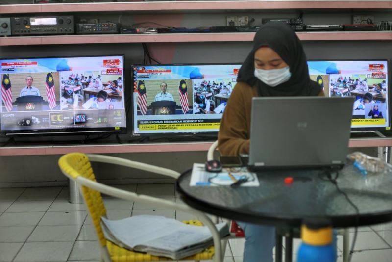 Prime Minister Tan Sri Muhyiddin Yassin announces the recovery movement control order during a live broadcast in Kuala Lumpur June 7, 2020. ― Picture by Ahmad Zamzahuri