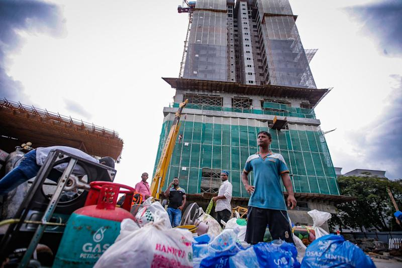 Construction workers moving out from temporary quarters inside the contraction side in Taman Desa, Kuala Lumpur February 15, 2020. — Picture by Hari Anggara