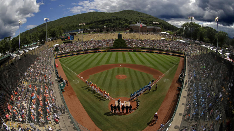 FILE - In this Sunday, Aug. 25, 2019, file photo, River Ridge, Louisiana, lines the third baseline and Curacao lines the first baseline during team introductions before the Little League World Series Championship game at Lamade Stadium in South Williamsport, Pa. The 2020 Little League World Series and the championship tournaments in six other Little League divisions have been canceled because of the new coronavirus pandemic. (AP Photo/Gene J. Puskar, File)