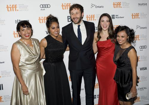 """FILE - In this Sept. 9, 2012 file photo, Deborah Mailman, from left, Jessica Mauboy, Chris O'Dowd, Shari Sebbens and Miranda Tapsell pose for a photo on the red carpet at the Elgin Theatre for the film """"The Sapphires"""" during the 2012 Toronto International Film Festival in Toronto. Feel-good musical drama """"The Sapphires"""" sparkled at Australia's premier film awards. The tale of an Aboriginal family singing group entertaining American troops in the Vietnam War won best film and five other awards at the Australian Academy of Cinema and Television Arts ceremony Wednesday night, Jan. 30, 2013. Best Lead Actress Mailman and Best Supporting Actress Mauboy won for playing sisters in the group and O'Dowd won the lead actor award for playing the group's talent manager. (AP Photo/The Canadian Press, Aaron Vincent Elkaim, File)"""