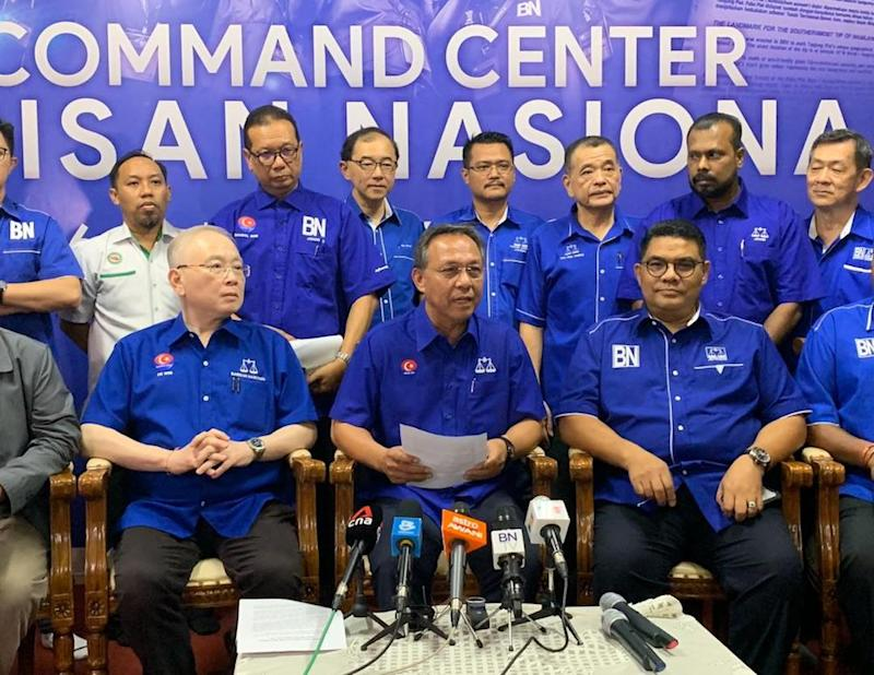 Johor Barisan Nasional chief Datuk Hasni Mohammad (centre) officially named MCA's Datuk Seri Wee Jeck Seng as its candidate for the Tanjung Piai parliamentary by-election on November 16. — Picture by Ben Tan