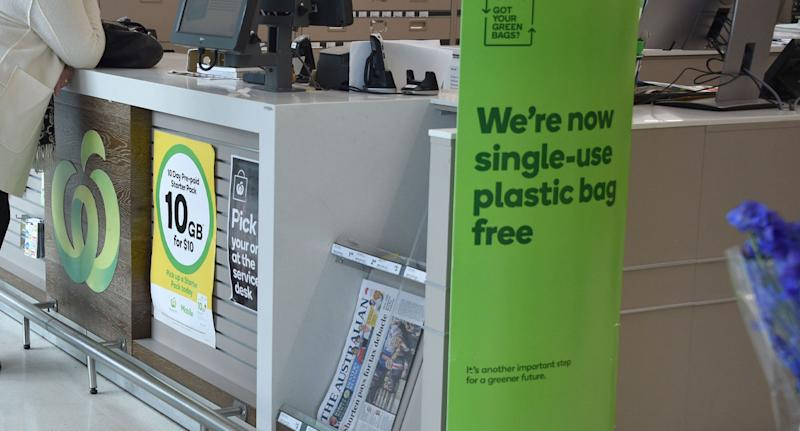 """Photo of Woolworths sign claiming it was working towards a """"greener future""""."""