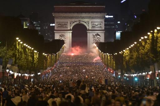 Celebrations at the Arc de Triomphe on the Champs Elysees in Paris after France's World Cup semi-final win