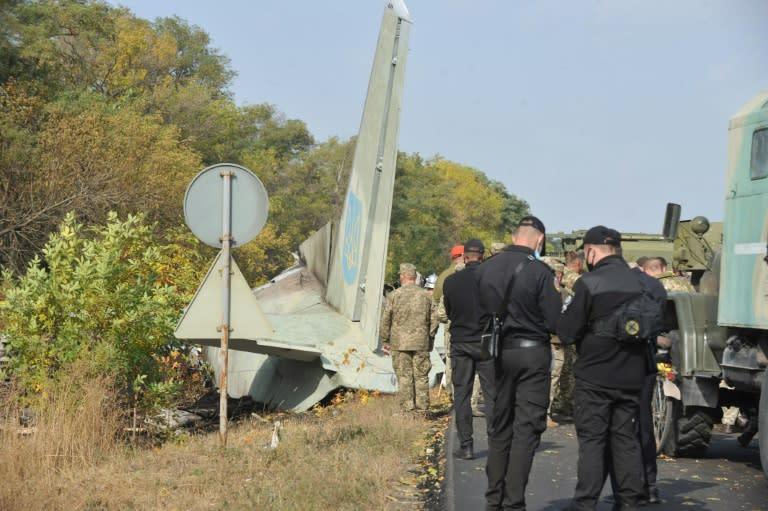 Ukraine leader praises crash survivor as toll climbs to 26