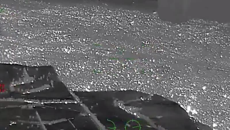 An aerial footage filmed from the Victoria Police helicopter with thermographic camera shows the bushfires in Mallacoota