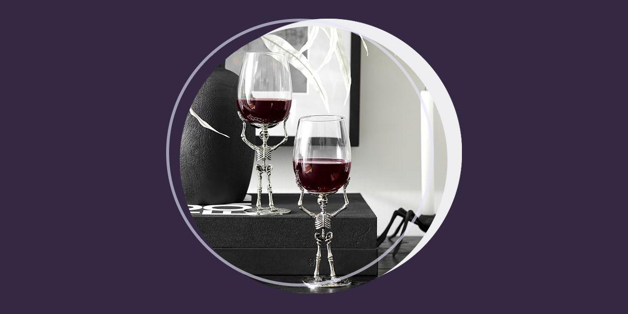 """<p>For us, the most fun part of Halloween is the <a href=""""https://www.bestproducts.com/halloween-decorations/"""" target=""""_blank"""">creepy home decor</a> that we get to whip out, including proper Halloween glassware for our haunted home bar. Since no Halloween hangout with the ghouls is complete without Halloween wine glasses, we decided to do the research for you to find the creepiest goblets and chalices out there.</p><p>From spooky-chic matching wine glass sets to some seriously blinged-out, sugar skull-inspired goblets, here are our picks for the absolute best Halloween wine glasses that you can buy this season. Just remember to get your <a href=""""https://www.bestproducts.com/eats/drinks/a1399/alcoholic-halloween-punch-recipe/"""" target=""""_blank"""">killer Halloween punch recipe</a> ready before your ghoulish guests arrive.</p>"""