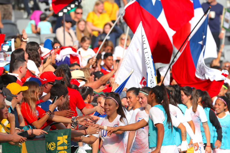 Players from Chile shake hands with their supporters after the Women's International Friendlies soccer match between the Matildas and Chile at Bankwest Stadium in Sydney, Saturday, Nov. 9, 2019. Football Federation Australia said a record crowd of 20,029 were attracted for the women's soccer match in Australia. (David Gray/AAP Image via AP)
