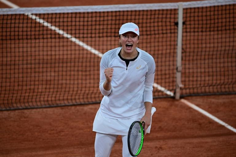 'Surprised' Swiatek stuns top seed Halep to reach Roland Garros quarter-finals