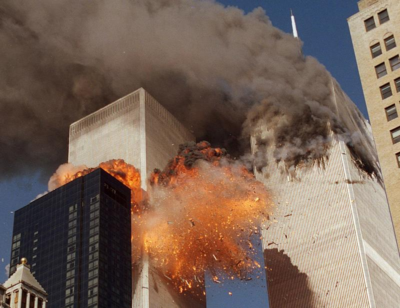 smoke billows from World Trade Center Tower 1 and flames explode from Tower 2 as it is struck by American Airlines Flight 175, in New York.