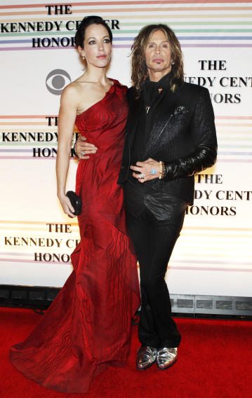 FILE - In this Dec. 10, 2010 file photo, Erin Brady, left, and Steven Tyler of Aerosmith, walk the red carpet at the Kennedy Center Honors in Washington. Tyler's representative confirmed Monday, Jan. 2, 2012, that the Aerosmith frontman is engaged to Erin Brady. (AP Photo/Jacquelyn Martin, File)