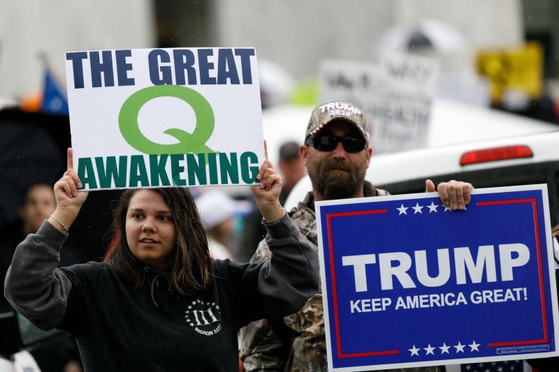 Protesters promote QAnon