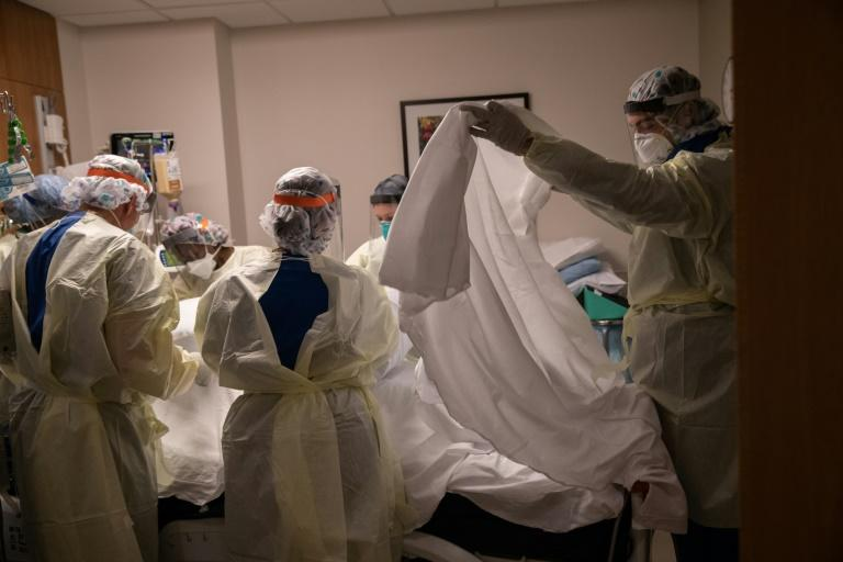 A medical team turns over a patient with COVID-19 in an intensive care unit in Stamford, Connecticut