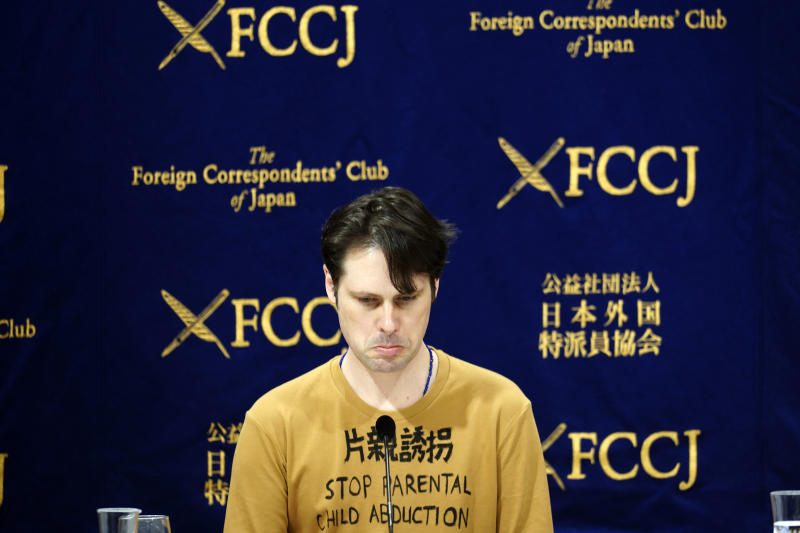 """Tokyo-based Australian journalist Scott McIntyre speaks during a press conference at the Foreign Correspondent's Club Japan in Tokyo Thursday, Jan. 16, 2020. McIntyre said he is a victim of """"inhumane"""" custody laws that allow only one side of the parents access to children of broken marriages, the day after he was convicted of trespassing at the apartment building of his estranged wife's in-laws for trying to find his children. (AP Photo/Eugene Hoshiko)"""