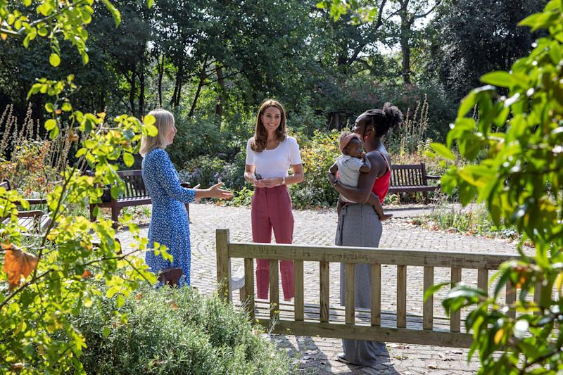 Britain's Catherine, Duchess of Cambridge, reacts as she meets with Morgan Alex Cassius and her six-month-old daughter, Makena Grace, in Battersea Park, London on September 22, 2020, where she learned more about the benefits of parent-to-parent support. (Photo by Jack Hill / POOL / AFP) (Photo by JACK HILL/POOL/AFP via Getty Images)