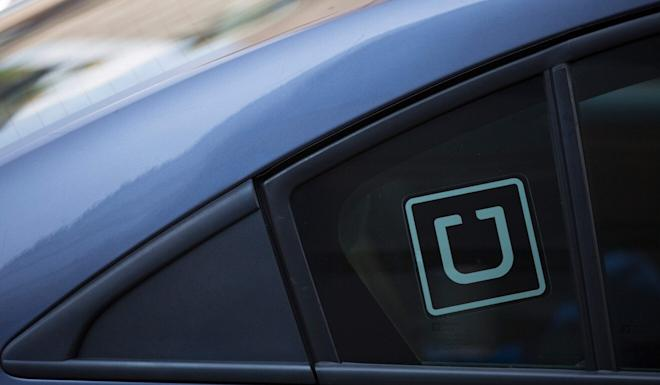 Carrying paying passengers without a hire-car permit is not legal in Hong Kong, though Uber has been operating in the city for six years. Photo: AFP