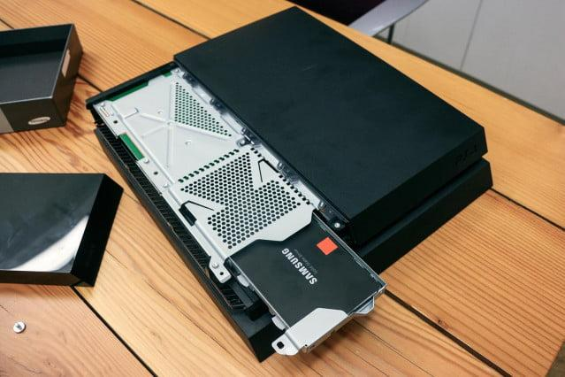Slide the hard-drive cage back into the PS4's hard drive bay.
