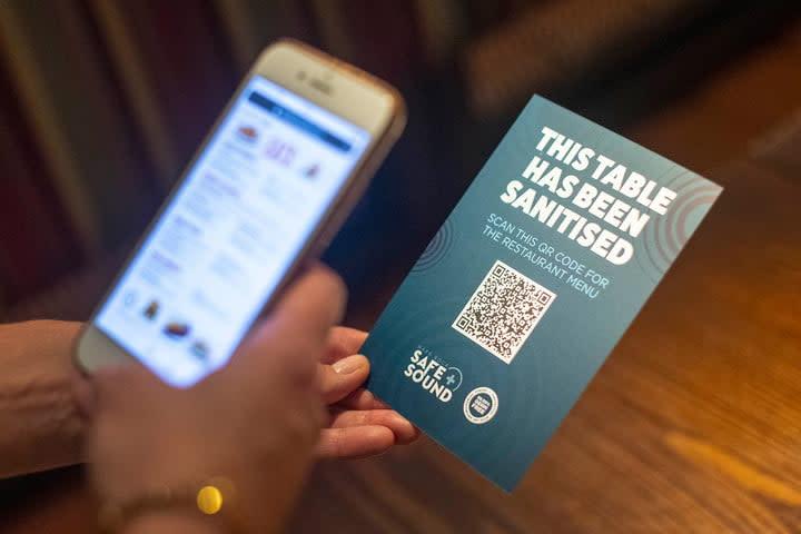 A QR code opens a digital restaurant menu