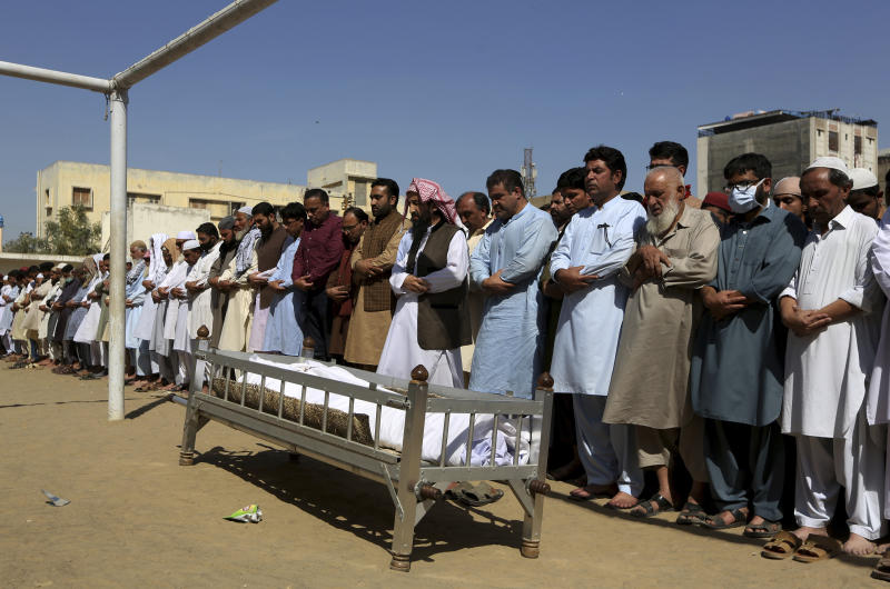 People offer funeral prayers for a victim of a toxic gas leak, during his funeral prayer, in Karachi, Pakistan, Monday, Feb. 17, 2020. The toxic gas leak killed several people and sickened dozens of others in a coastal residential area in Pakistan's port city of Karachi, police said Monday. The source of the leak, which occurred on Sunday night, and the type of gas that had leaked were not immediately known. There was no suspicion of sabotage. (AP Photo/Fareed Khan)
