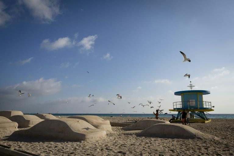 """Order of Importance"" a sculpture of more than 60 cars in sand made by Leandro Erlich can be found on Miami Beach"