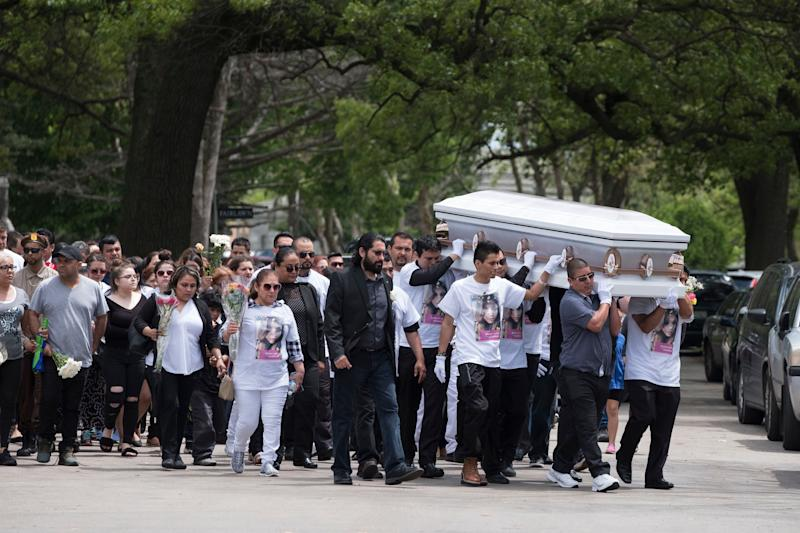 Mourners carry a casket at the funeral of Marlen Ochoa-Lopez at Mount Auburn Funeral Home in Chicago.