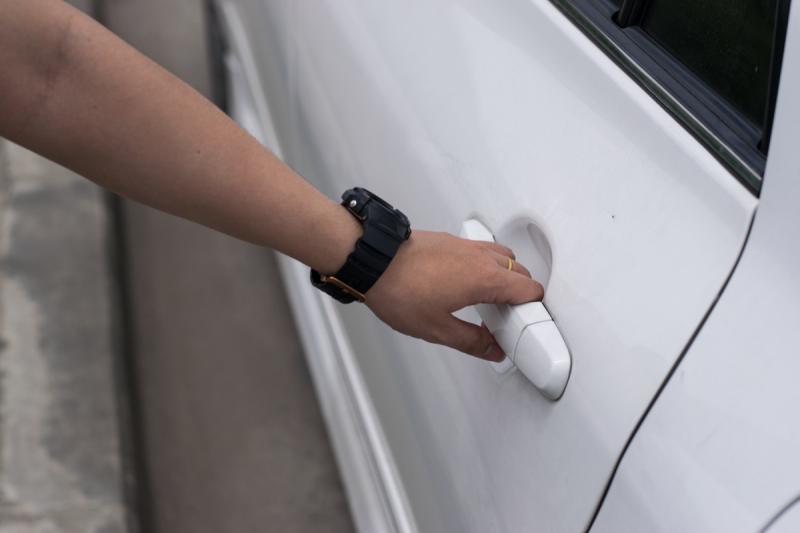 Person Opening a Car Door Inside of Their Garage DIY Home Hacks