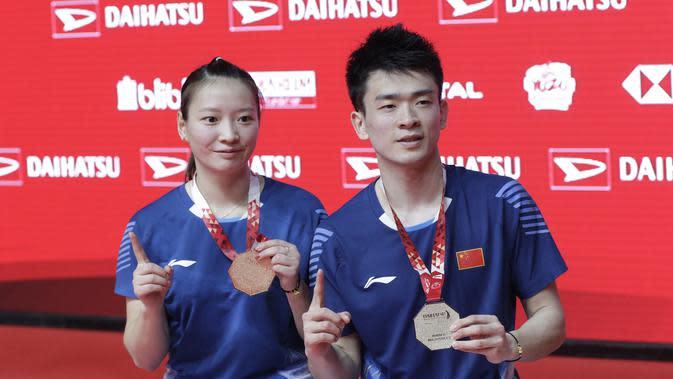 Pasangan Cina, Zheng Siwei/Huang Yaqiong. (Bola.com/M Iqbal Ichsan)