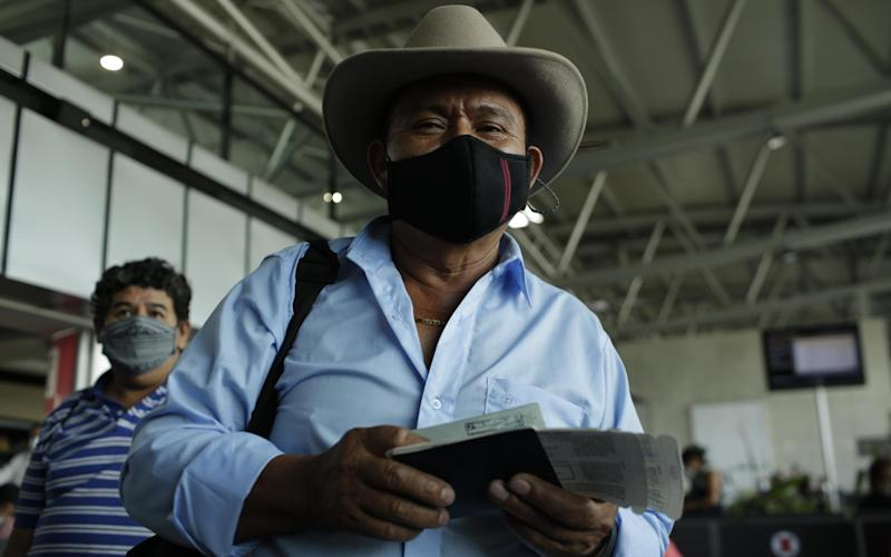 Passengers at La Aurora International Airport, Guatemala City - Getty