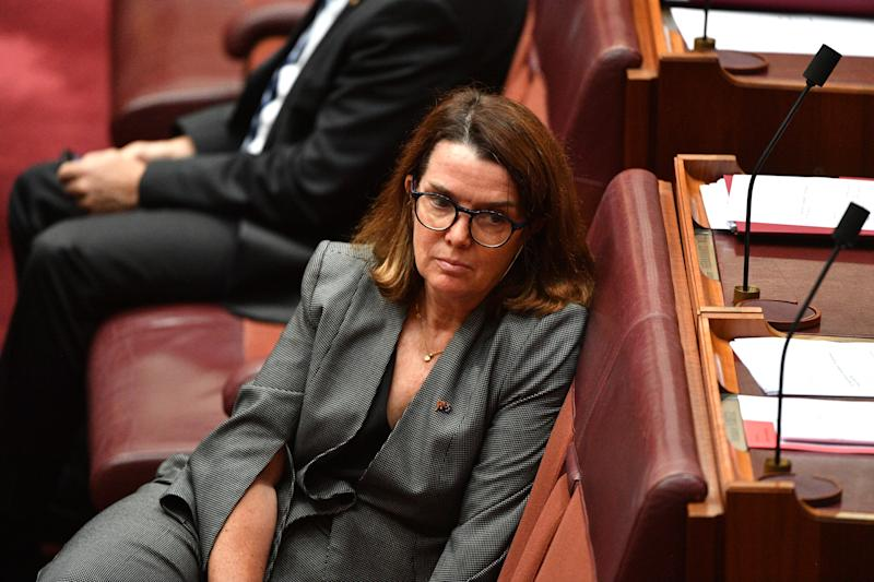 Pictured is Liberal Senator Anne Ruston wearing a grey suit in the Senate Chamber last year.