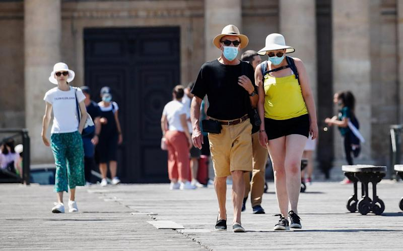 Masks are now compulsory in crowded outdoor areas in cities and towns across France - Gonzalo Fuentes/Reuters