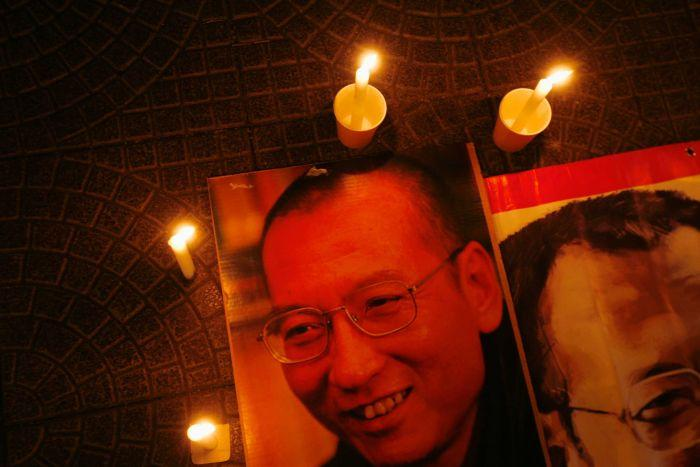 Candles are placed around portraits of jailed Chinese pro-democracy activist Liu Xiaobo during a candlelight vigil.