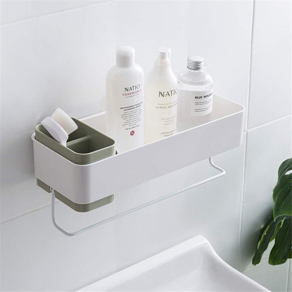 "<p>For a sleek, modern look, opt for this <a href=""https://www.popsugar.com/buy/She-Home-Bathroom-Wall-Organizer-466877?p_name=She%27s%20Home%20Bathroom%20Wall%20Organizer&retailer=amazon.com&pid=466877&price=23&evar1=savvy%3Aus&evar9=46366430&evar98=https%3A%2F%2Fwww.popsugar.com%2Fphoto-gallery%2F46366430%2Fimage%2F46366667%2FPerfect-Right-Above-Your-Tub&list1=shopping%2Camazon%2Corganization%2Cshowers%2Cbathrooms&prop13=api&pdata=1"" rel=""nofollow"" data-shoppable-link=""1"" target=""_blank"" class=""ga-track"" data-ga-category=""Related"" data-ga-label=""https://www.amazon.com/SHES-HOME-Bathroom-Organizer-Toothbrush/dp/B07P7KZTK9/ref=sxbs_sxwds-stvp?keywords=shower+organizer&amp;pd_rd_i=B07P7KZTK9&amp;pd_rd_r=8dd5141a-4c33-4684-b020-8a74845fea16&amp;pd_rd_w=IhZJB&amp;pd_rd_wg=drJqP&amp;pf_rd_p=a6d018ad-f20b-46c9-8920-433972c7d9b7&amp;pf_rd_r=TN7SHEA0B8HVAHHE4G8F&amp;qid=1562864628&amp;s=gateway"" data-ga-action=""In-Line Links"">She's Home Bathroom Wall Organizer</a> ($23).</p>"