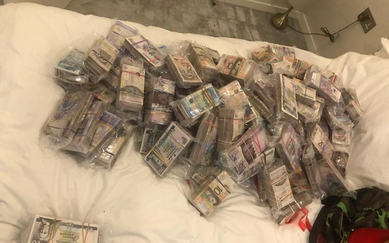 Cash seized by officers under the operation - Metropolitan Police