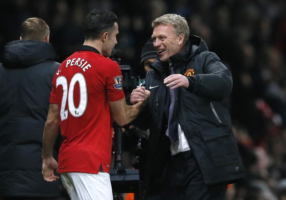 Manchester United's manager Moyes celebrates with van Persie after their English Premier League soccer match against Arsenal in Manchester