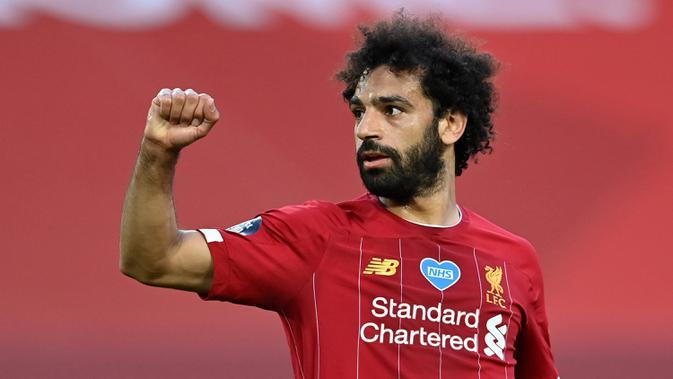 1. Mohamed Salah (Liverpool) - Mohamed Salah, sangat ahli meneror pemain belakang lawan dengan kecepatan, dribel yang taktis dan penyelesaian akhir yang brilian. Hanya selama tiga musim bersama The Reds, dia membukukan 91 gol dan 27 assist dalam 144 penampilan. (AFP/paul Ellis/pool)