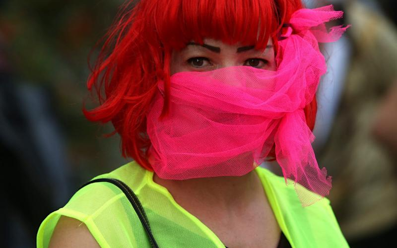 A woman wears a mask to slow the spread of coronavirus in Germany - Adam Berry