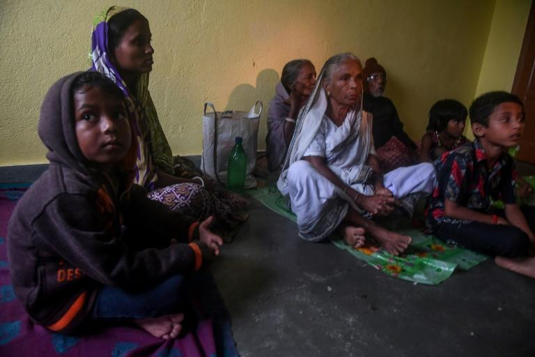 Villagers in Bakkhali, India take shelter inside a relief centre as Cyclone Bulbul approached