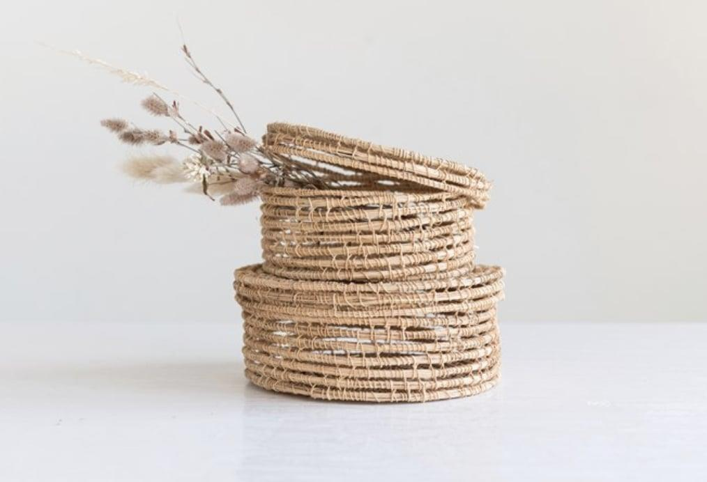 """<p>There's so much she can do to decorate her home with these <a href=""""https://www.popsugar.com/buy/Hand-Woven-Palm-Boxes-w-Lid-583342?p_name=Hand-Woven%20Palm%20Boxes%20w%2F%20Lid&retailer=thefondhome.com&pid=583342&price=15&evar1=savvy%3Aus&evar9=25946384&evar98=https%3A%2F%2Fwww.popsugar.com%2Fsmart-living%2Fphoto-gallery%2F25946384%2Fimage%2F47560974%2FHand-Woven-Palm-Boxes-w-Lid&list1=shopping%2Cgift%20guide%2Cgifts%20for%20women%2Cgifts%20under%20%24100%2Cgifts%20under%20%2450%2Cgifts%20under%20%2475&prop13=mobile&pdata=1"""" rel=""""nofollow"""" data-shoppable-link=""""1"""" target=""""_blank"""" class=""""ga-track"""" data-ga-category=""""Related"""" data-ga-label=""""https://thefondhome.com/products/hand-woven-palm-boxes-w-lid"""" data-ga-action=""""In-Line Links"""">Hand-Woven Palm Boxes w/ Lid</a> ($15).</p>"""