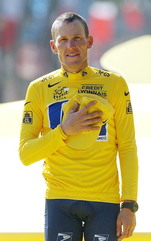 FILE - In this July 25, 2004 file photo, Lance Armstrong holds his hand on his chest as he listens to national anthems after winning his sixth straight Tour de France race, in Paris The superstar cyclist, whose stirring victories after his comeback from cancer helped him transcend sports, chose not to pursue arbitration in the drug case brought against him by the U.S. Anti-Doping Agency. That was his last option in his bitter fight with USADA and his decision set the stage for the titles to be stripped and his name to be all but wiped from the record books of the sport he once ruled. (AP Photo/Christophe Ena, File)