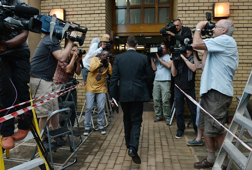 Oscar Pistorius enters court Tuesday, Oct. 14, 2014 to face day two of sentencing processes for the shooting death of his girlfriend Reeva Steenkamp. Pistorius was found guilty last month on a culpable homicide charge. (AP Photo)
