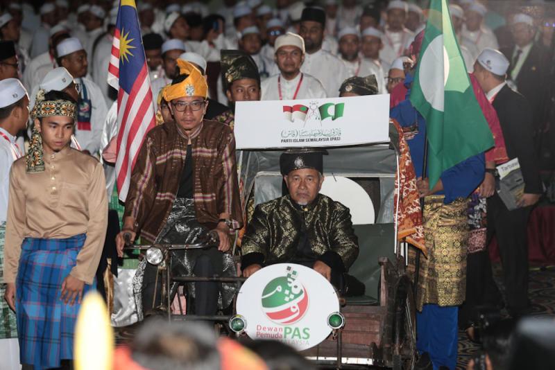 PAS Youth chief Muhammad Khalil Abdul Hadi and PAS deputy president Datuk Tuan Ibrahim Tuan Man enter the main hall at the start of Pemuda proceedings during Muktamar 2019 in Gambang, Pahang June 19, 2019. — Picture by Zamzahuri Abas