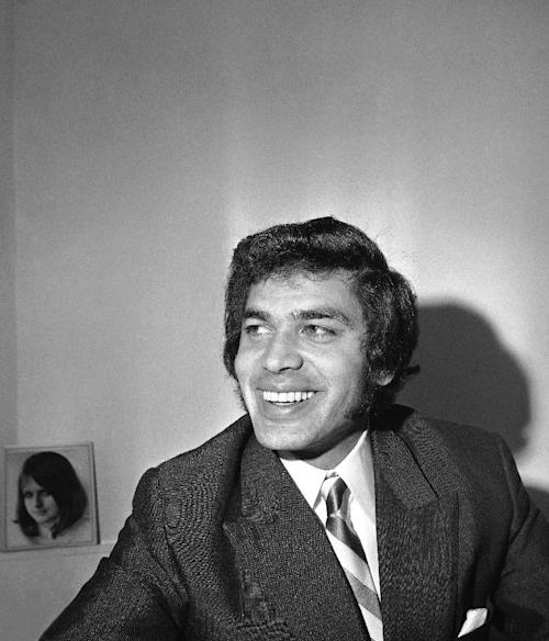 FILE - In this file photo dated Dec. 13, 1968 British pop singer, Engelbert Humperdinck, smiles during an Associated Press interview with London newsman Don McNicoll. After years of disappointment, Britain is staking its Eurovision hopes on 75-year-old Engelbert Humperdinck, the square-jawed crooner who famously beat the Beatles to the number 1 spot in 1967. The 57th Eurovision Song Contest will be held in May 2012 in Baku, Azerbaijan. (AP Photo/Bob Dear, file)