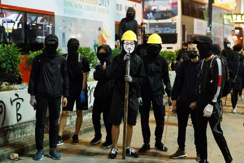 Protesters stand in Nathan Road before facing off with police during a protest in Mong Kok in Hong Kong