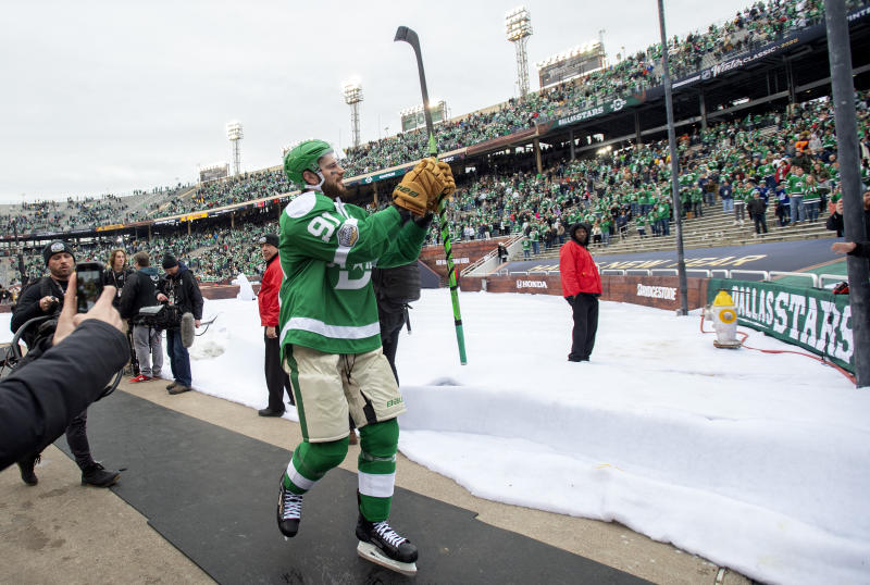 Dallas Stars center Tyler Seguin (91) acknowledges the crowd after the NHL Winter Classic hockey game against the Nashville Predators at the Cotton Bowl, Wednesday, Jan. 1, 2020, in Dallas. Dallas won 4-2. (AP Photo/Jeffrey McWhorter)