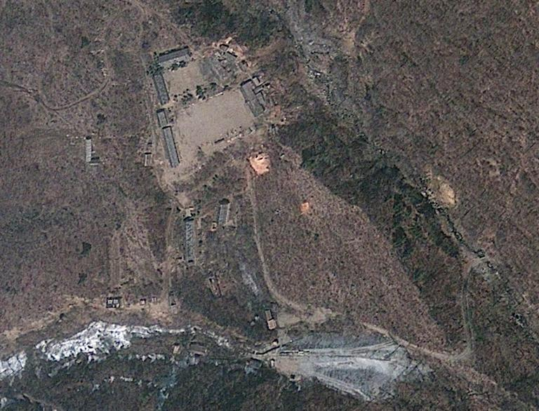 FILE - In this April 18, 2012 file satellite image provided by GeoEye appears to show a train of mining carts, at the lower center of the frame, and other preparations underway at North Korea's Punggye-ri nuclear test site but no indication of when a detonation might take place, according to analysis by the U.S.-Korea Institute at Johns Hopkins School of Advanced International Studies. If getting international attention is North Korea's goal, then there is nothing quite like detonating a nuclear device to make your adversaries sit up and take notice. But experts say North Korea probably has a long way to go before it will be able to actually deploy a nuclear weapon. (AP Photo/GeoEye, File)