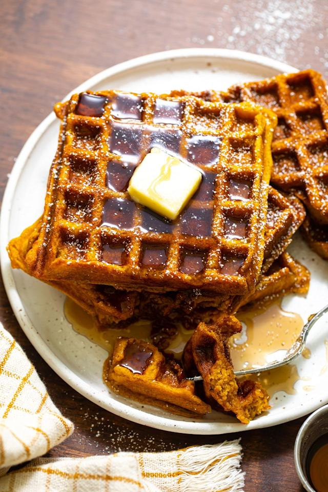 "<p>How <em>incredible</em> do these look? </p><p>Get the recipe from <a href=""https://www.delish.com/cooking/recipe-ideas/a33393833/pumpkin-waffles/"" target=""_blank"">Delish</a>.</p>"