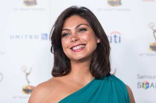 Actress Morena Baccarin arrives at the 65th Primetime Emmy Awards Performers Nominee Reception at the Pacific Design Center on Friday, Sept. 20, 2013 in Los Angeles. (Photo by Paul A. Hebert/Invision/AP)