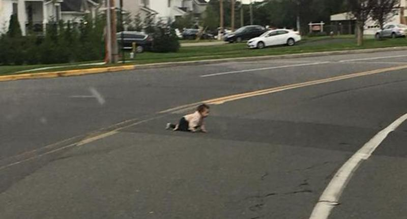 A Lakewood baby was spotted crawling across a busy road in the New Jersey suburb.